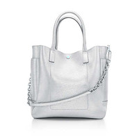 Tiffany & Co. - Riley tote in silver metallic grain leather. More colors available.