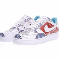Supreme x Kaws x Bape x Nike Air Force 1 Low Sneaker AQ0889-100