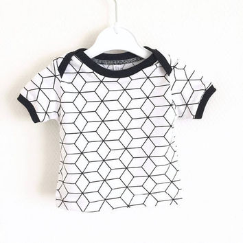 Baby lap neck shirt with geometric pattern. Toddler t-shirt. Kid's top. White shirt with black pattern. Cotton knit fabric.