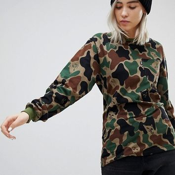 Rip N Dip Relaxed Long Sleeve Pocket T-Shirt With Rude Cat And Sleeve Print at asos.com