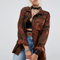 Milk It Vintage Military Jacket In Overdye Camo at asos.com