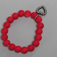 Red handmade children's wrist bracelet with plastic beads and heart charm