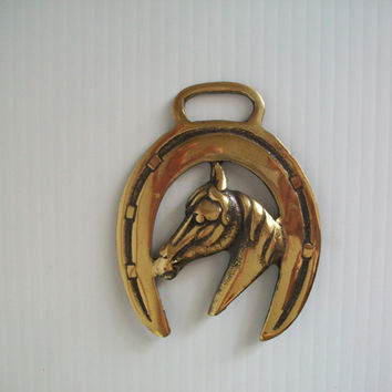 vintage brass horse harness medallion . vintage harness straps . horse brass . leather strap brass harness . solid brass emblem