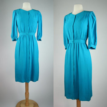 1980's silk secretary dress in teal blue w long sleeves nipped waist front button up Maggie London Petites size 4 size XS