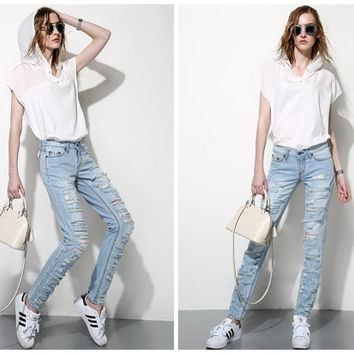 women ripped jeans in blue,acid wash jeans,distressed,fashion,mod,for summer,spring.autumn.