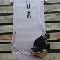 Our The House That Built Me Tunic Dress - Cocoa is an adorable dress with a little sass to it! It is a short sleeve tunic dress with a high slit up the sides that cross over. It is true to size.