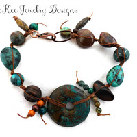 Turquoise stone, stone, wood and metal knotted with cording bracelet.