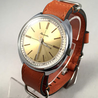 "LARGE Vintage men's watch ""Raketa ""(eng.Rocket).Soviet mechanical watch with rare dial.Comes with new quality leather band!"