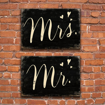 Mr. and Mrs. wooden signs.  Approx. 19x.13x75 inches.  Black distressed background with cream color lettering.  Handmade and made to order.