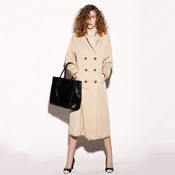 long trench coat for women in tan featuring double-breasted,vintage,characters printed at back,loose fit,oversize,fringed hem,slit at back.