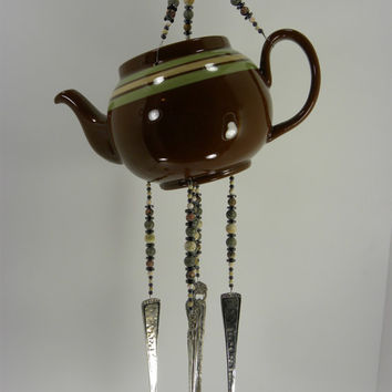 Wind chime ceramic tea pot with stone beads and silver plated flatware earth tones