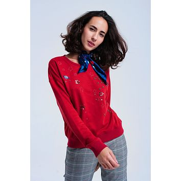 Red sweatshirt with beads
