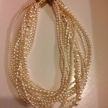 Eleven string Faux fresh water pearls necklace. Very good condition.