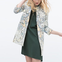 Pixellated print coat