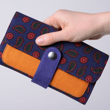 Handmade two colored women's wallet sewn of cotton and linen fabrics with stud