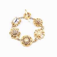 Golden Color Cut Out Flowers Linked Bracelet