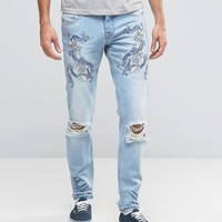 ASOS Skinny Jeans With Embroidery In Light Blue at asos.com