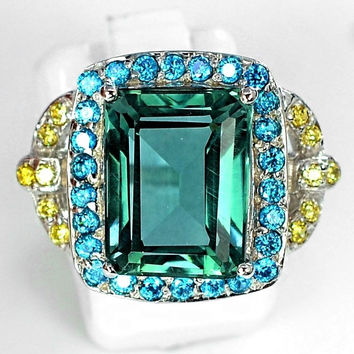 A perfect vintage 7CT emerald cut aquamarine yellow sapphire blue apatite accent engagement ring