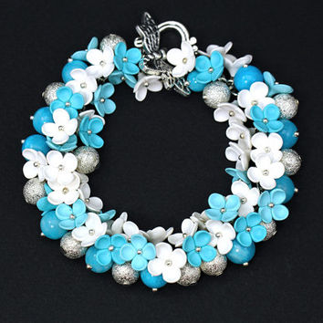 Floral Bracelet with White and Turquoise Flowers One of  King Jewelry