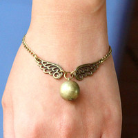 Steampunk Enchanted Golden Snitch wings bracelet by Sevinoma