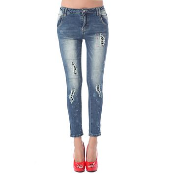 Jeans in high quality fabric with stud embellished