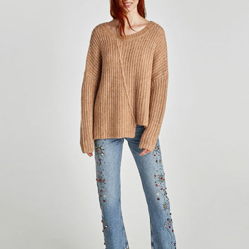 ASYMMETRIC SWEATER WITH VISIBLE SEAM DETAILS