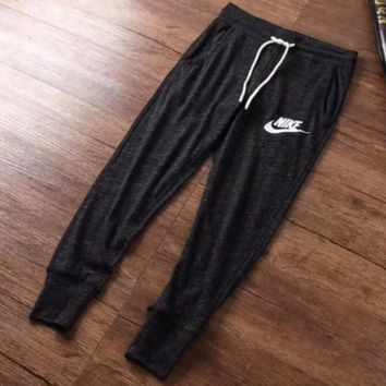 NIKE 2018 new women's thin section knit casual cropped trousers closed mouth pants F0664-1 black