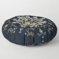 Pale Gold Floral Design On A Blue Textured Background Floor Pillow by inspiredimages