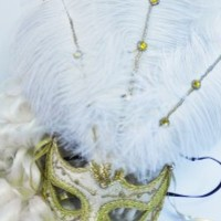 Venetian style costume mask Mardi Gras Carnivale gold white feathers