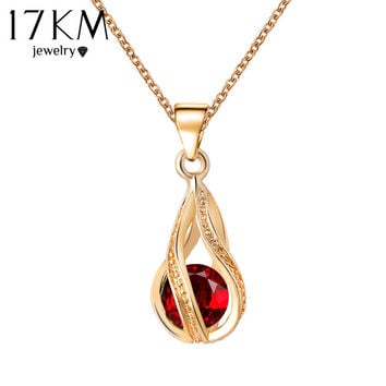 Long Austrian Crystal Water Drop Necklace with a red stone. Classic Style of Beauty.