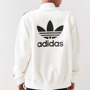 Best adidas bomber jacket products on wanelo for Adidas floral shirt urban outfitters