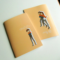 Notebook with Larry Stylinson fanart on it, inspired by Stockholm Syndrome by One Direction