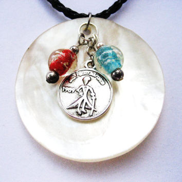 The little prince  necklace with coin ,  large shell and glow in the dark glass beads