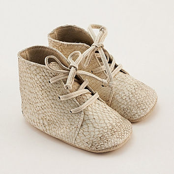Baby shoes from beige fish leather