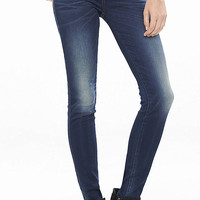 Dark Mid Rise Extreme Stretch Jean Legging from EXPRESS