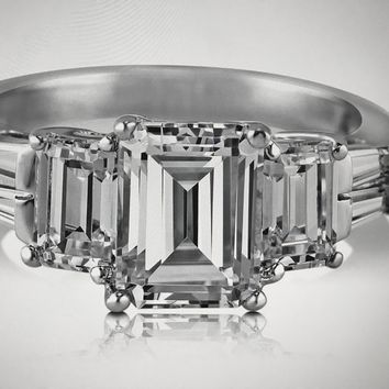 A Perfect 2.3CT Emerald Cut & Step Cut Trapezoid Engagement Ring