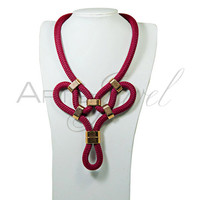 Statement necklace in burgundy color