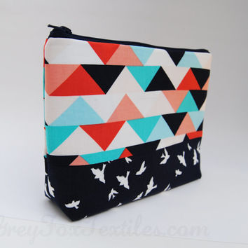 Handmade designer fabric Geometric triangle print cosmetic case peach, navy, aqua, turquoise, coral, and white, accented with a bird print