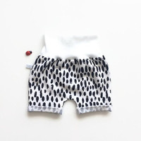 White baby or toddler shorts with black dots. Comfy slim fit shorts. Organic cotton knit fabric.
