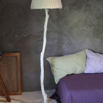 A floor lamp, made of recycled materials: painted driftwood, oak of already chopped down trees, sailcloth (inside) and wool
