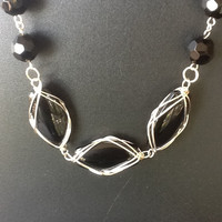Wire wrapped black bead necklace with sterling silver clasp