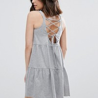 ASOS PETITE Sleeveless Smock Sundress With Lace Up Back at asos.com