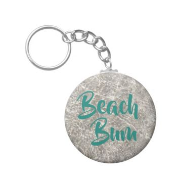 Sparkeling water on sand beach bum keychain