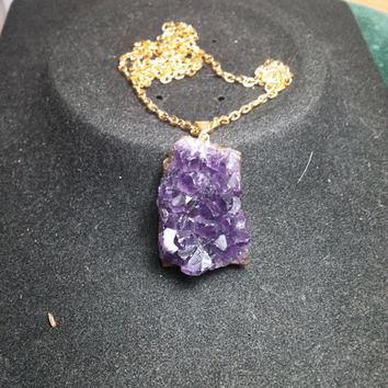 Rough Amethyst Crystal Point in gold Tone necklace