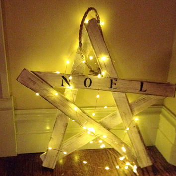 Handmade wooden rustic star handpainted with Noel and comes with rope to hang.  Approx. 16x15.5x.75  Lights NOT included.