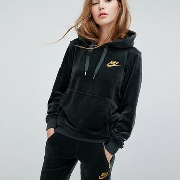 Nike Exclusive Velour Pullover Hoodie In Outdoor Green at asos.com