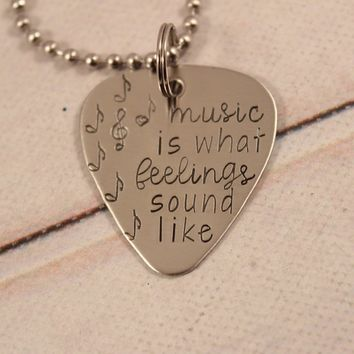 """""""Music is what feelings sound like"""" Hand stamped Guitar Pick Necklace / Keychain"""