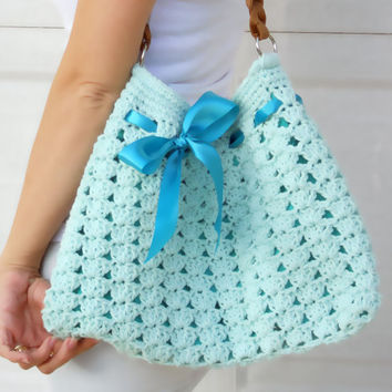 Crochet shoulder purse tote bag with ribbon in teal.