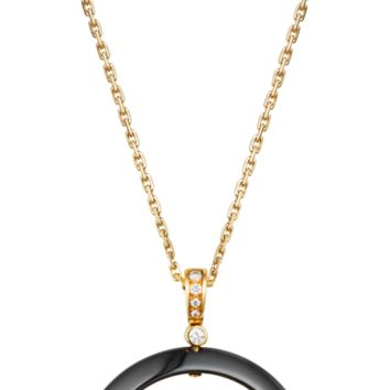 Panthère de Cartier necklace: 18K yellow gold necklace set with ceramic ring, black lacquer spots, onyx nose, tsavorite garnet eyes and diamonds.