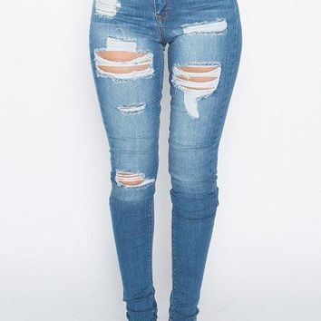 High waisted distressed cutout denim jeans
